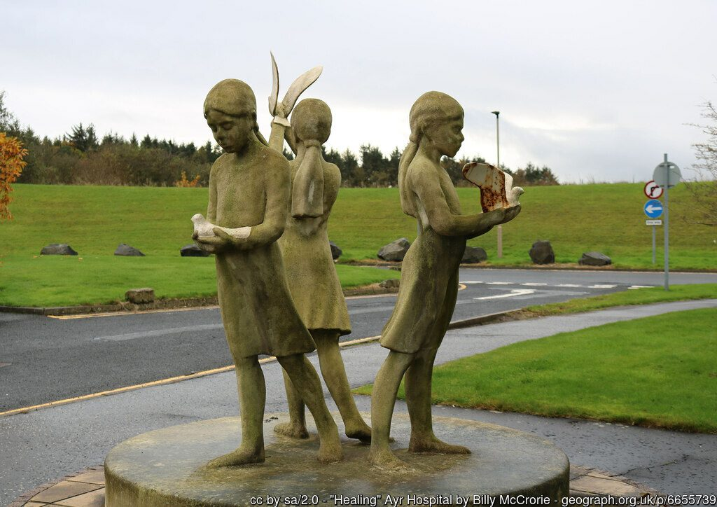 Statue showing three children holding doves